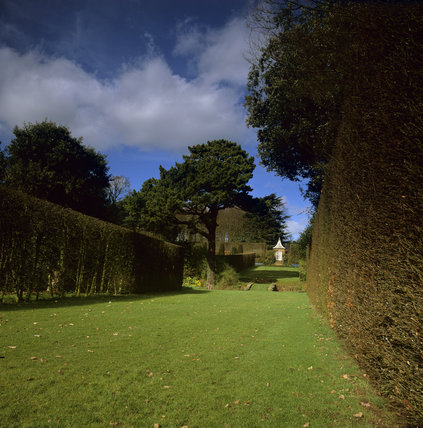 Looking down a grassy glade to a pavilion in the grounds of Hidcote