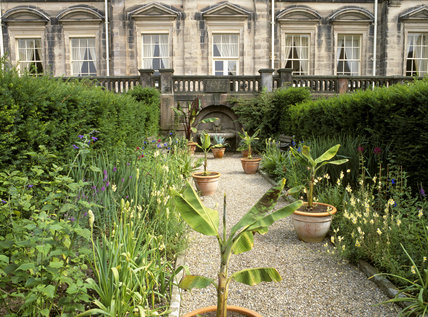 A view across Mrs. Bateman's Garden towards the fountain set beneath the stone balustrade adjacent to Biddulph Grange.