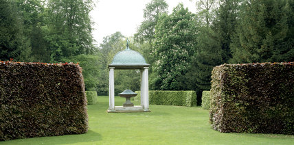 A temple with a porphyry domed bowl in the grounds of Anglesey Abbey