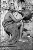 Samburu man with a beer pot