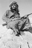 Salim bin Ghabaisha with a rifle