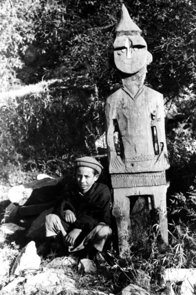 Boy with a carved wooden figure