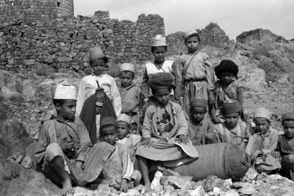 Yemeni boys with an unexploded bomb