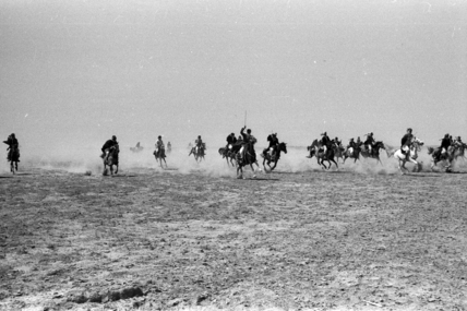 Al Essa men on horseback