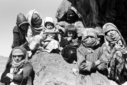Women and children sheltering in a cave