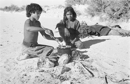 Boys cooking an evening meal