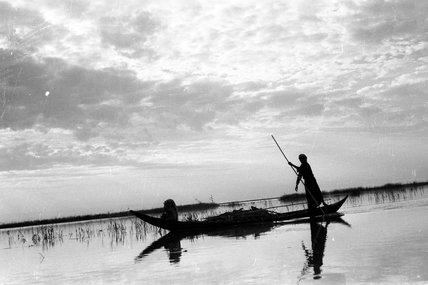 Madan men in a boat in the Marshes
