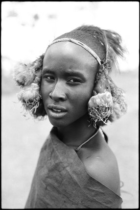 Samburu youth wearing a headdress