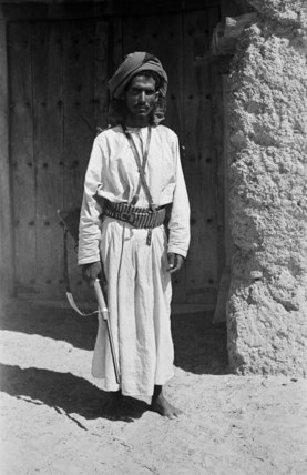 Musallim bin al Kamam with a rifle