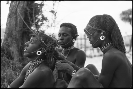 Samburu moran braiding hair