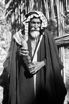 Madan man with a wooden pipe