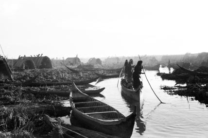 Boats at a settlement in the Marshes