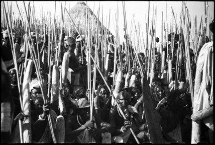 Dinka men with spears at a funeral dance