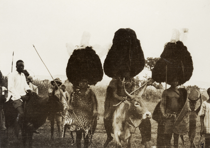 Luo men wearing headdresses