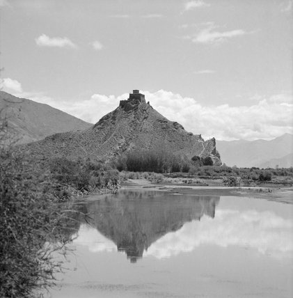 Chakpori reflected in the waters of the Kyichu river