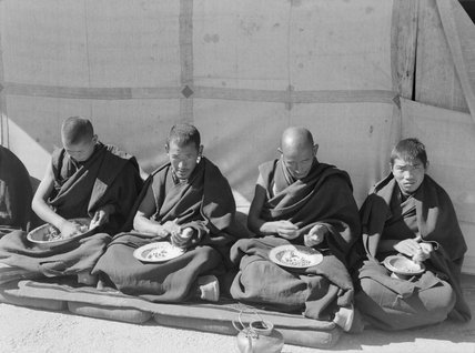 Four monks eating