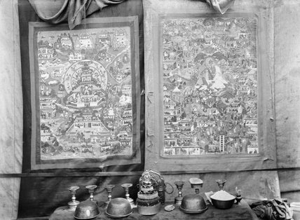 Two Thanka behind altar with offering bowls