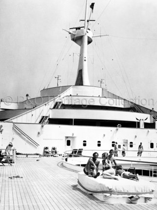 Passengers relaxing on CANBERRA's deck