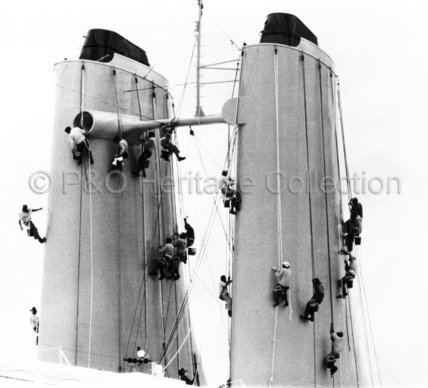 Crew members cleaning CANBERRA's funnels
