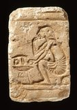 Egyptian relief with a man eating fruit, from El-Amarna