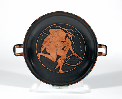Athenian cup interior, man with a lyre and staff