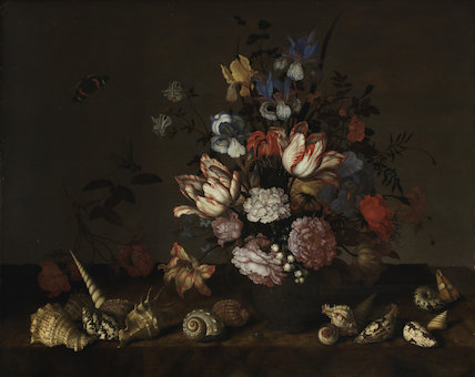 A vase of flowers with shells