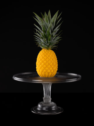 A pineapple-shaped ice cream with a real pineapple crown
