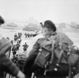 British commandos of 1st Special Service Brigade, led by Lord Lovat, landing on 'Queen Red' sector of Sword Beach, at La Breche, on the morning of 6 June 1944.