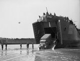 A lorry disembarks from a landing ship on the Normandy beaches, 7 June 1944.