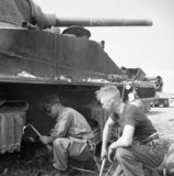 REME personnel cutting suspension components from a Sherman tank at a vehicle salvage dump in Normandy, 1 August 1944.