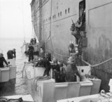 American troops climb into assault landing craft from the liner REINA DEL PACIFICO during Operation 'Torch', the Allied landings in North Africa, November 1942.
