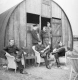 Australian pilots of No. 452 Squadron relax outside their dispersal hut at Kirton-in-Lindsey, 18 June 1941.