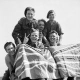 British Prisoners of War celebrate their liberation from Stalag 11B at Fallingbostel, 16 April 1945.