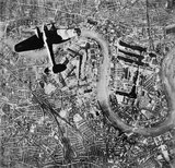 A Heinkel He 111 bomber flying over the East End of London at the start of the Luftwaffe's evening raids of 7 September 1940.