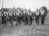 Pilots of No. 303 (Polish) Squadron RAF with one of their Hawker Hurricanes, October 1940.