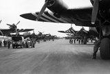 Short Stirling Mk IVs of Nos. 196 and 299 Squadrons RAF lining the runway at Keevil in Wiltshire, before emplaning paratroops of the 5th Parachute Brigade Group for the invasion of Normandy, 5 June 1944.