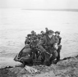 Men of the 15th (Scottish) Division use a small assault craft to cross the Rhine near Xanten, 24 March 1945.