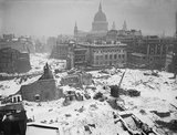 A winter scene of Bomb damaged buildings around St Paul's Cathedral, January 1942.