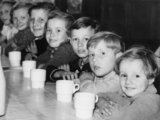 Four young Belgian refugees enjoy bread and jam for tea in London during 1940.