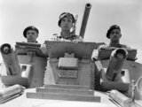 Turret crew of a 1st Royal Tank Regiment A9 Cruiser Mk I tank at Abbasia, Egypt, 30 May 1940.