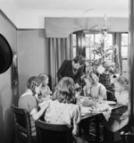 Christmas 1944 in the Devereux house in Pinner. The Christmas tree was a gift from Mr Devereux, who was serving in Italy. The tree was purchased through the 'Gifts to Home League' of the YMCA.