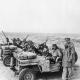 Colonel David Stirling, founder of the Special Air Service, with an SAS jeep patrol in North Africa, 18 January 1943.