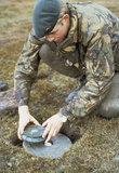 A Royal Marine defuses an Argentine anti-personnel mine in the Falkland Islands, June 1982.