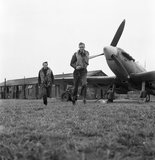 American volunteer pilots of No.121 (Eagle) Squadron run to their aircraft at RAF Rochford in Essex, August 1942.
