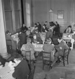 Members of the public enjoying a meal in one of the chain of British Restaurants established during the Second World War, London, 1943.