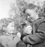 Two your refugees from Luxembourg with their pet rabbit in Surrey duirng 1942.