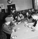 American volunteer pilots of No.121 (Eagle) Sqaudron playing poker in the dispersal hut at RAF Rochford in Essex during August 1942.