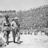 Winston Churchill leaves the old Roman amphitheatre at Carthage in Tunisia with First Army Commander, Lieutenant General Anderson, after addressing British troops on 1 June 1943.