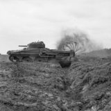Sherman Crab Mk II flail tank, one of General Hobart's 'funnies' of 79th Armoured Division, during minesweeping tests in the UK, 27 April 1944.