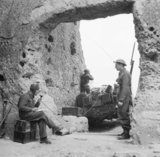 Men of the King's Royal Rifles man an observation post in the Garigliano area of Italy, 30 January 1944.